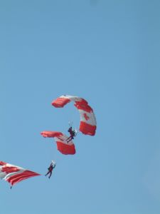 Three of the Canadian Skydiving Team performing
